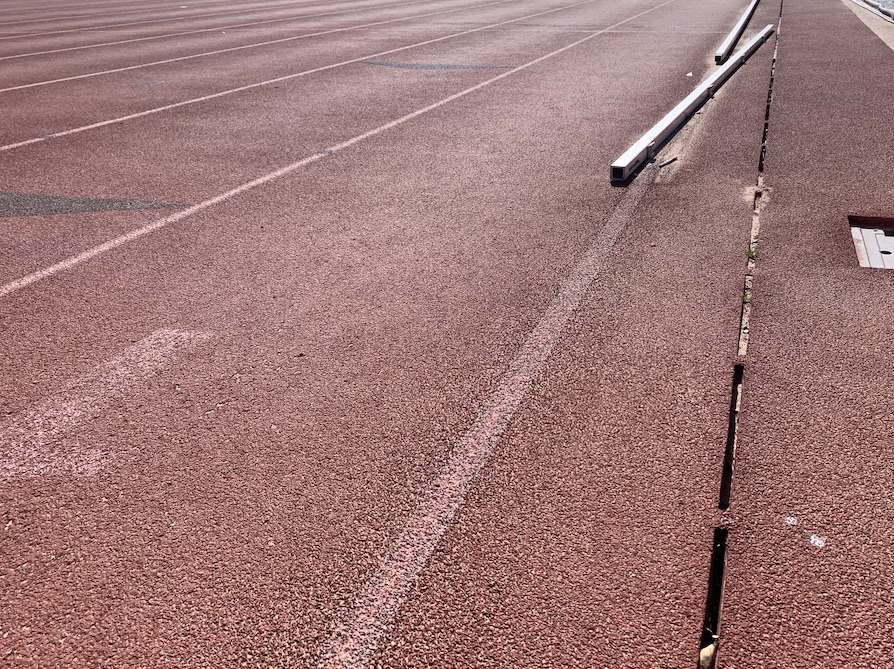 This running track is getting the works from RS Global: a deep track cleaning, running track repairs, drain clean out, and re-striping.